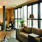 Tilt_and_turn_full_height_shutters_in_dark_grey
