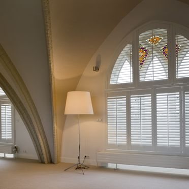 Tall_arched_white_shutters