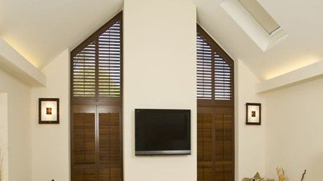 Triangular, triangle, bespoke, custom fit, tailor_made, wood_coloured_shutters,
