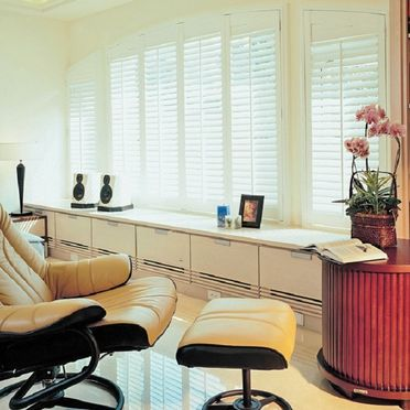 Arched_white_shutters